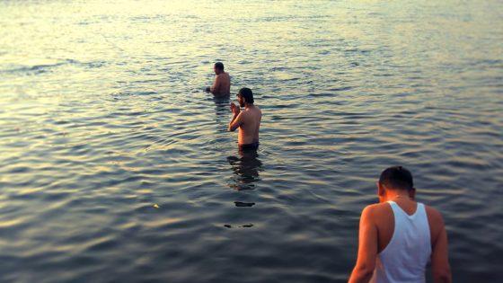 Dipping in Narmada River